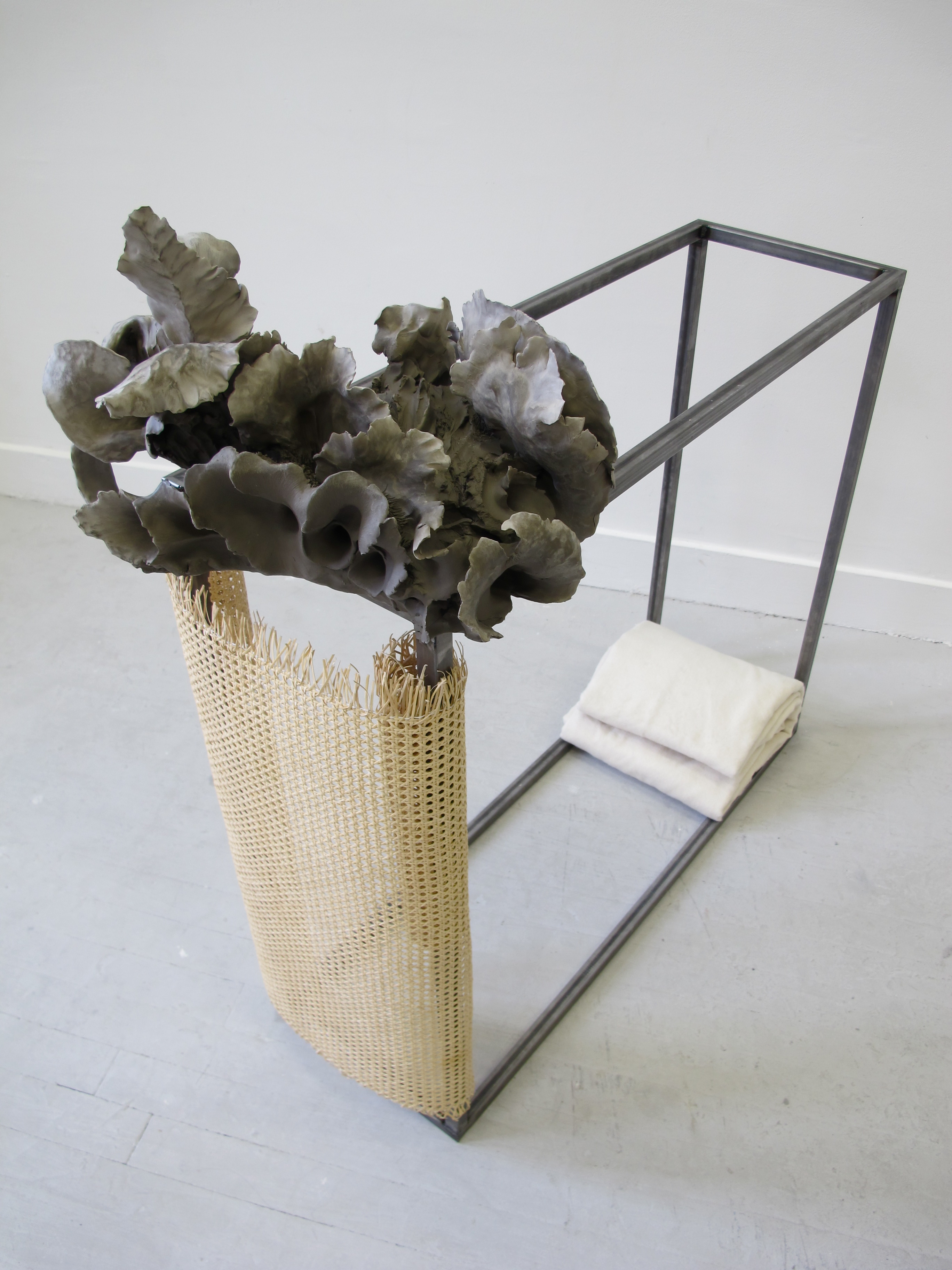 Untitled 2012 Unfired clay, wicker, steel, cotton